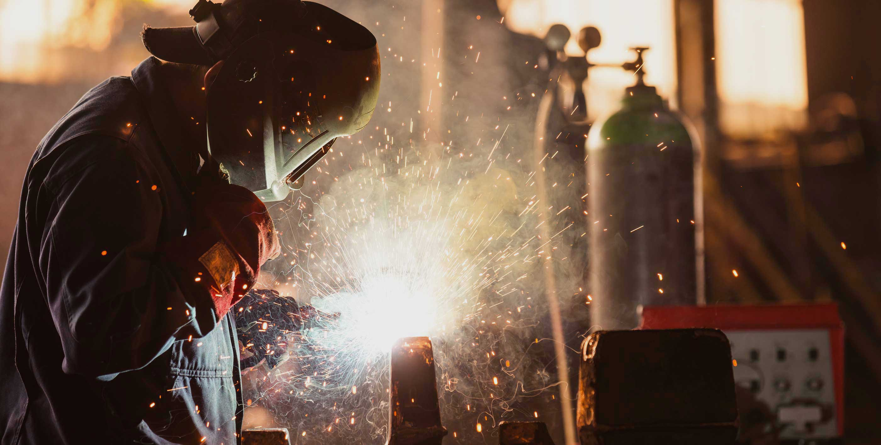 bigstock-Industrial-Worker-at-the-facto-723322541